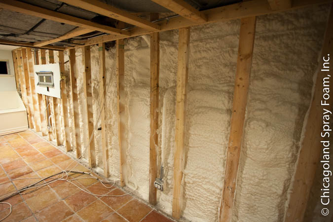 Basement wall sprayed with waterproof closed cell spray foam insulation.