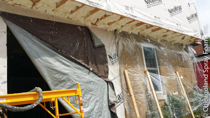 This Chicago home was sprayed with spray foam insulation to help with cold floors above.